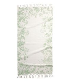light green floral cotton rug with fringe - H&M DESCRIPTION Cotton rug with a printed pattern. Fringe at short sides. Size 30 x 55 in. DETAILS 100% cotton. Hand wash cold