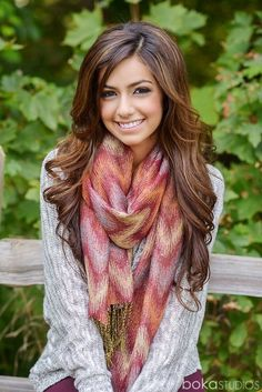 Everything goes together! The hair, the sweater, the scarf! Even liken the look of the purple pants