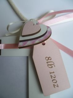 Photo frame close-up tag with heart embellishments.