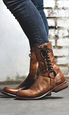 Tan lace side Moto styled BEDSTU boot, is styled with medium washed denim.