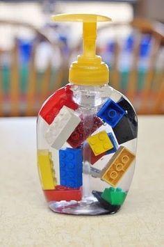 lego soap dispenser. Put legos in soap for boys and beads or mismatched barbie shoes for girls.