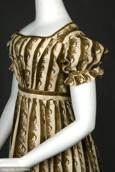 Cornucopia print day dress, 1815-25. White cotton printed with brown in stripe and floral cornucopia...