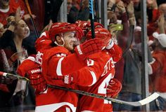 Detroit Red Wings center Gustav Nyquist, of Sweden, celebrates his goal against the Boston Bruins with teammates in the second period of a NHL hockey game in Detroit Thursday, Oct. 9, 2014. Photo: Paul Sancya, AP / AP