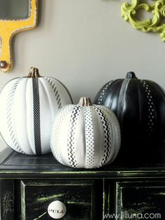Get creative with washi tape by adding stripes of your choice to a painted pumpkin.