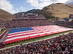 The American Flag being revealed at a Griz game in Washington-Grizzly Stadium! Go USA! Go Griz!