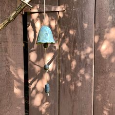 Blij om dit item uit mijn #etsy shop te delen: Handmade grey blue ceramic bell. Artisan wallhanging made of grey clay - Indoor and outdoor decoration. Garden decoration Wind Chimes, Wall Lights, Ornament, Ceramics, Outdoor Decor, Etsy, Home Decor, Ceramica, Appliques