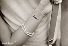 """love"" tattoo I'd love to have something like this one."