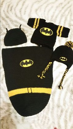 Crocheted batman cacoon, sweater, and hats