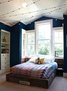 Twinkle Lights in Kids Rooms. Love the color of the walls and lights in the vaulted ceiling!