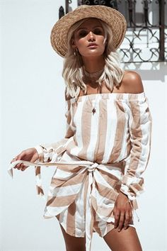 The super cute Seaside Striped Playsuit is made from a lightweight, textured fabric with nude stripes throughout. It is an off shoulder style and features overlay detailing at shorts, tie up at waist and full length sleeves with ties at cuffs. Complete the look with slides and a cute hat! By Sabo Skirt.