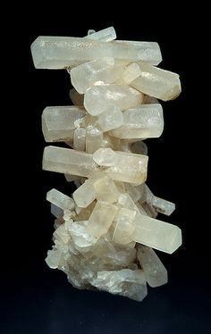 Calcite (CaCO3)   Bizarre nailhead calcite stalactite from Hilton Mine, Cumbria.The other polymorphs are the minerals aragonite and vaterite. Aragonite will change to calcite at 380-470°C,[5] and vaterite is even less stable.Calcite crystals are trigonal-rhombohedral, though actual calcite rhombohedra are rare as natural crystals. However, they show a remarkable variety of habits including acute to obtuse rhombohedra, tabular forms, prisms, or various scalenohedra.