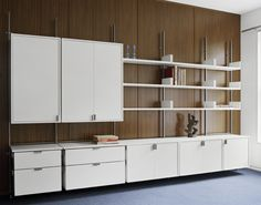 as4 in opaque lacquer: Executive Office  the as4 modular furniture system configuration in a corporate office, solid hardwood bookshelves, drawers, and cabinets shown in white opaque lacquer and bronze metal components