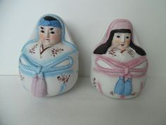 Set of Two Round Ceramic Asian Male and Female Figurines