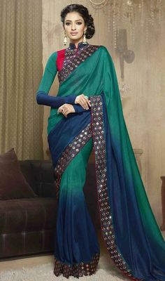Make the masses fall in love with your looks as you don this green and blue color shade silk embroidered sari. The lace, stones and unique border work on saree personifies the total look. #stunningsaricollection #shadedsarees #mirrorworksaris