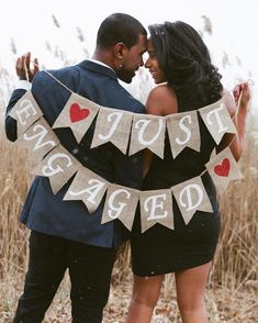 """Cutest #engagement photo! Love the sign and the snow flurries  