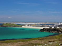 view of west side of St Ives across the ocean from the cliffs on the Cornish coastal path