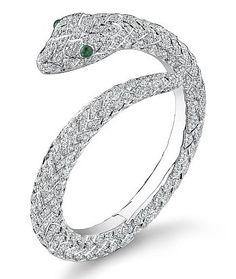 Asprey's Protector bangle. Pavé diamond bangle with emerald eyes, set in white gold. carats of diamonds total. Snake Jewelry, Emerald Jewelry, Animal Jewelry, Jewelry Bracelets, Jewelery, Silver Jewelry, Fine Jewelry, Women Jewelry, Bangles