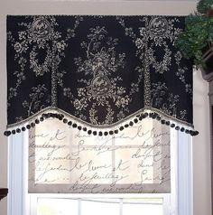 black & white valance with pom pom trim, and fabric shade.