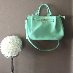 Gorgeous Mint Green Purse Love this color! Mint purse with gold detailing. In great condition on the inside! Missing one gold stud on the bottom of the purse but you can't tell because it's on the bottom Bags