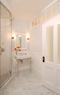 Add windows to a windowless bathroom, even if they're not to the outside world. More