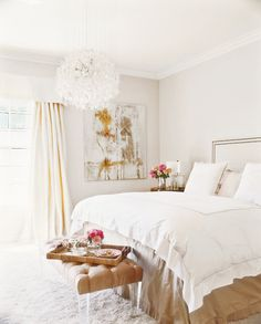 White decor with photography framed in white. #Style #Interior #Bedroom