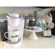 Instagram fan jess__jelly sets up her Keurig coffee station! Get yourself a Keurig brewer and enjoy over 400 varieties of coffee, tea, hot cocoa, or more at the touch of a button. Coffee Station Kitchen, Coffee Bars In Kitchen, Coffee Bar Home, Home Coffee Stations, Coffee Nook, Coffee Corner, Coffee Maker, Coffee Shops, Coin Café