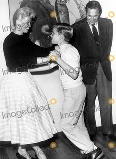 Doris Day dancing with her son Terry Melcher, age 11   with her husband Martin Melcher looking on