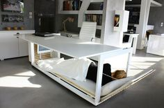 Transformer desk turns into a bedroom. In China, this works for the after-lunch catnap, but I prefer it as a solution for urban dwellers in tiny spaces. Improvements: 1) Desk frame telescopes to double in width, depth & height; 2) Add a hinged 2nd desk surface to expand it into a giant dining / party table; 3) Bed has a trundle to accomodate two joinable futons = 1 queen bed; 4) Add fabric shade rollers to the bottom of the desk to hide the luxury underneath! :)