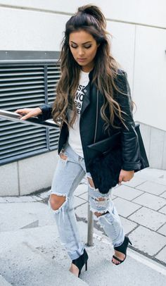 Jeans and black leather jacket.