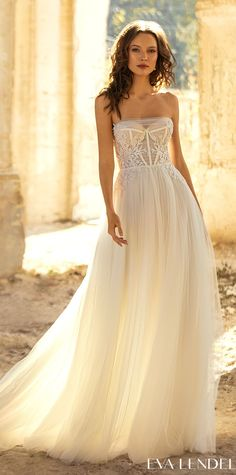 A-line tulle wedding dress style with a lace bodice, sweetheart neckline and corset bodice for the romantic bride | Flowy bridal gown design Eva Lendel Wedding Dresses 2021- Golden Hour Collection - Kollet - Belle The Magazine See more gorgeous bridal gowns by clicking on the photo