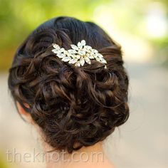classic simplicity updo with pinned curls and front sidepart