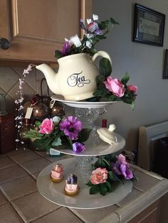 Love the flowers spraying out of the tea pot