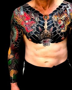 Super bold Japanese sleeve + chest tattoos by These tattoos are so cool! Chest Tattoo Japanese, Japanese Tiger Tattoo, Japanese Tattoos For Men, Japanese Dragon Tattoos, Traditional Japanese Tattoos, Japanese Tattoo Designs, Japanese Sleeve Tattoos, Tattoo Designs Men, Traditional Chest Tattoo