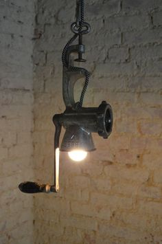 How about a pendant light made from a meat grinder?