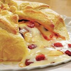 Holiday Brie en Croute Recipe Appetizers with pepperidge farm puff pastry sheets, eggs, water, apricot preserves, dried cranberries, toasted slivered almonds, brie cheese, crackers