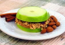 No bread? Use apple slices to make this easy, healthy snack sandwich filled with nut butter and crunchy granola!