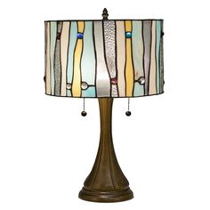 Bring light and beauty into your room with this contemporary Tiffany-style table lamp. Handcrafted by artisans using pieces of stained glass, this lamp has a zinc-alloy base with a elegant bronze finish. This lamp turns on and off with two pull chains.