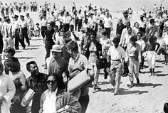 "Rainbow Beach Rainbow Beach, extending from 75th to 79th along Lake Michigan in South Shore, was one location where black and white youth vied for space. On Saturday and Sunday, July 7 and 8, 1961, an interracial coalition of demonstrators, many of them members of the NAACP Youth Council, staged a ""freedom wade-in"" at Rainbow Beach.  http://www.encyclopedia.chicagohistory.org/pages/1040.html"