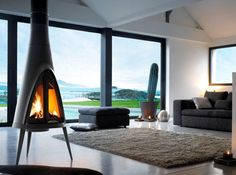 Invicta Tipi Wood Stove - won't give installation charge, ecah project different. Can get flu parts estimate online for free. Hanging Fireplace, Stove Fireplace, Modern Fireplace, Fireplace Design, Midcentury Fireplaces, Foyers, Interior Exterior, Interior Design, Stylish Interior