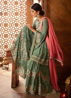 Sage Green & Coral Pink Designer Heavy Embroidered Georgette Sharara Suit Sage Green & Coral Pink Designer Heavy Embroidered Georgette Sharara S – Saira's Boutique Pakistani Bridal Dresses, Pakistani Dress Design, Pakistani Outfits, Indian Outfits, Dress Indian Style, Indian Dresses, Gharara Designs, Dress Designs, Fashion Clothes