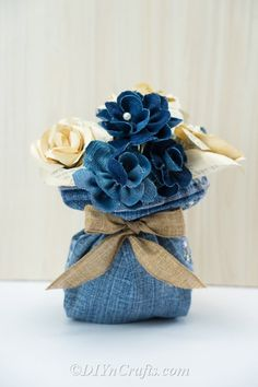 How to Make Beautiful Flowers Out of Old Jeans - Did you know you can create beautiful flowers out of an old pair of jeans and turn them into a rustic centerpiece? Find out how to do it.