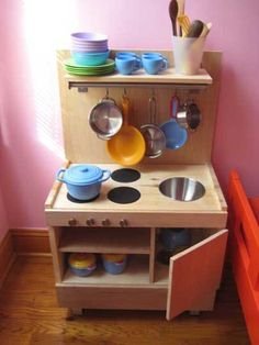 We are continually blown away by the creativity and ingenuity of our readers, and the recent run of homemade toy kitchens we've featured here is a case in point