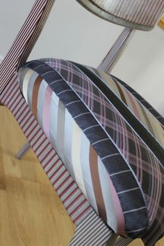 Decoupage Tie Chair (£50 from the sale for Helen Rollason Cancer Charity) The chair has been decoupaged in stripes the upholstered with ties which have been hand sewn into the seat to make the chair useable (some of the ties are 100% silk so this product will need to be use...