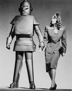 """atomic-flash: """"The Metalogen Man & Babs (Carol Matthews), a robot from the 1945 serial, The Monster and the Ape (Columbia Pictures). """"Created by Professor Franklin Arnold, the Metalogen Man is stolen. Arte Robot, I Robot, Cool Robots, Robot Girl, Vintage Robots, Retro Robot, World Of Tomorrow, Sci Fi Films, Columbia Pictures"""