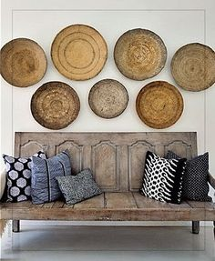 Frog Hill Designs Blog Love the antique vintage bench seating and globally inspired textile pillows. Woven baskets provide the perfect artwork. #vintagebench #navajobowl