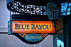 "One of the favorite restaurants in Disneyland Park is the Blue Bayou. Since opening in 1967, it has become a family tradition for many Guests to dine on the delicious Cajun- and Creole-style food in a truly unique setting.    Ambience    Inside the Pirates of the Caribbean attraction, Guests at the Blue Bayou sit ""outdoors"" in perpetual twilight, surrounded by winking fireflies and the soothing sounds of the bayou's crickets and frogs"