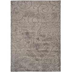 @Overstock - This power-loomed shag rug offers luxurious comfort and unique styling with a raised high-low pile. High-density polypropylene pile features a grey background and provides one of the most plush feels available in a rug.http://www.overstock.com/Home-Garden/Hand-woven-Ultimate-Dark-Grey-Shag-Rug-8-x-10/5665186/product.html?CID=214117 $232.04