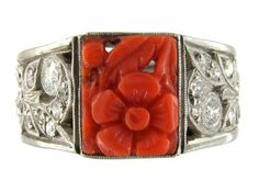 Carved Coral Ring With Diamond Sides Set In Platinum