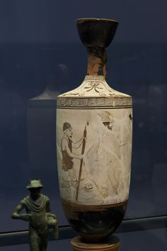 "Hermes leads a deceased woman to the Charon's ship.   Attic white-ground red figured Lekythos Attributed to ""The Thanatos Painter"" ca. 440 – 430 BC Munich. Antikensammlungen."