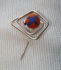 Repurposed upcycled Vintage knitting needle wirework shawl pin with felt bead. $12.50, via Etsy.